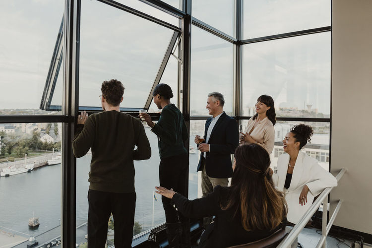Group of people standing by the window