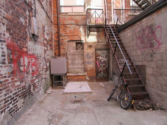 Alley Alleyway Alleyways Architecture Back Alley Broken Windows Built Structure City City Street Day Decrepit Factory Factory Building Graffiti Industrial Industrial Building  Industrial Stairs No People Rust Rusty Smashed Windows Vandalism