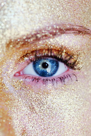 Cropped Image Of Woman With Gold Sparkled Face Paint