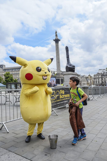 Happy boy with Pikachu character in Trafalgar Square, London, England, UK. Conversing Cosplay Happy London Mascot United Kingdom Adventures In The City Boy Caucasian Character Costume Day Editorial  Kid Lifestyles Meet Outdoors People Pikachu Trafalgar Square