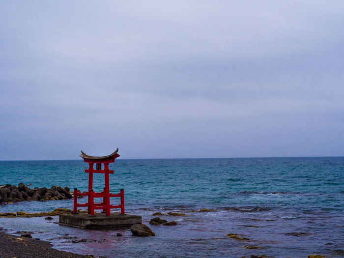 A Shrine Cloudy Sky Coast Ocean Rock Sacred Wave