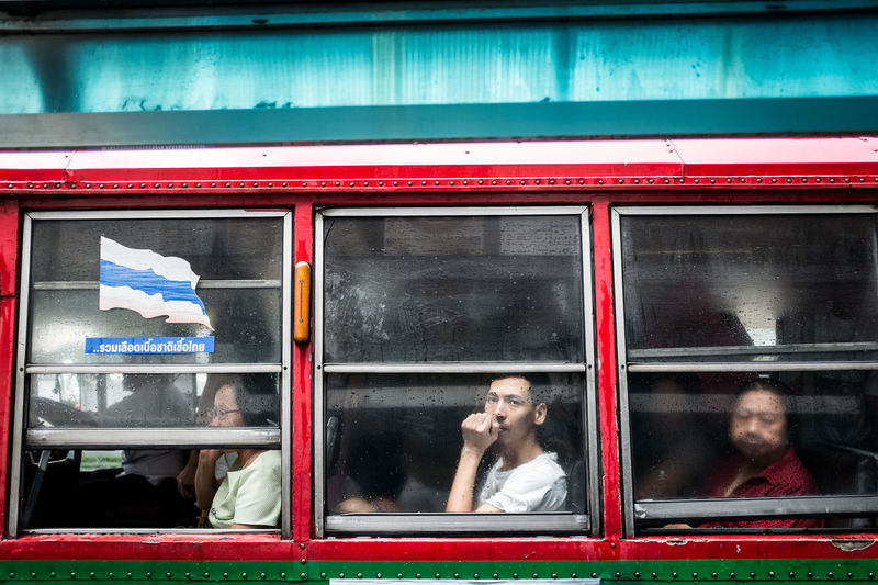On the bus stop in central Bangkok, Thailand Bangkok BKK Bus Bus Ride City City Life Commuters Commuting Eye Contact Journey Metropolis Passengers Rainy Day Real People South East Asia Street Photography Streetphoto Streetphoto_color Streetphotography Thailand Through The Window Traffic Travel Window Young Adult The Traveler - 2018 EyeEm Awards