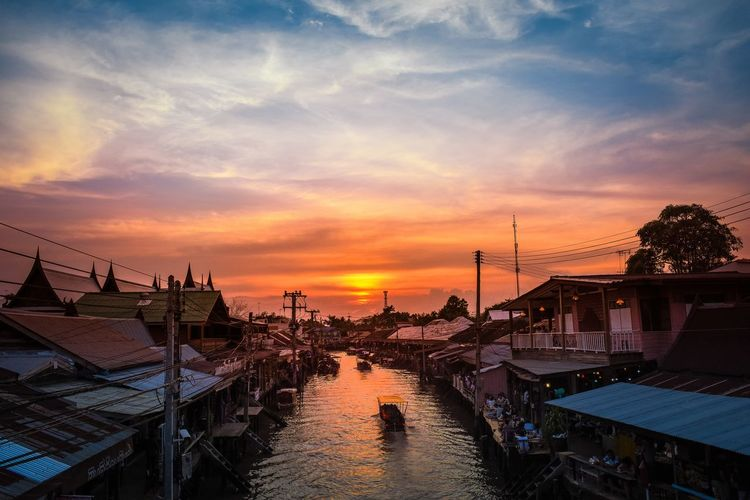 28 January 2018 Samut Songkhram Thailand boat in the river at Amphawa market Samut Songkhram Amphawa  Songkhram Architecture Beach Beauty In Nature Building Exterior Built Structure Cloud - Sky Day Harbor Horizon Over Water Moored Nature Nautical Vessel No People Outdoors Scenics Sea Sky Sunset Transportation Travel Destinations Vacations Water Yacht An Eye For Travel