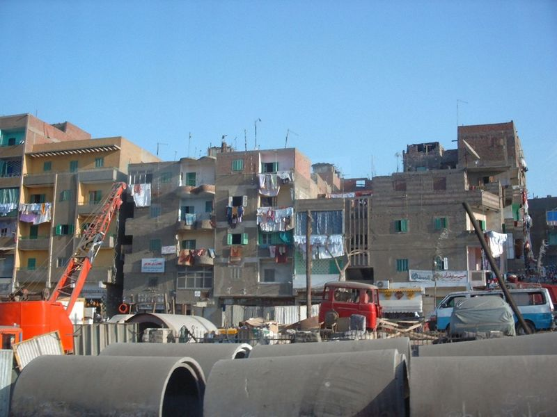 Not so pretty side of Cairo, 2002 Architecture Bad Neighborhood Blue Building Exterior Built Structure Car City Clear Sky Construction Site Day Junk Junk Cars Junk Yard Junkyard Land Vehicle Mode Of Transport No People Outdoors Real Life Photography Residential Building Sky Town Transportation