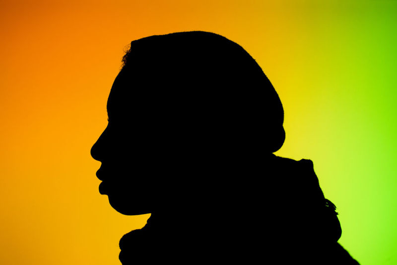 Silhouette of man against yellow background