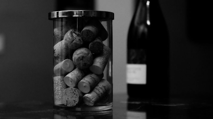 Close-Up Of Wine Cork In Glass Jar On Table