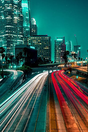 L.A. EyeEm Selects Illuminated Night Railroad Track City Speed Transportation City Life Skyscraper Urban Skyline Long Exposure Built Structure Motion Building Exterior Business Finance And Industry Light Trail Downtown District Architecture Travel Destinations Outdoors Cityscape Adventures In The City