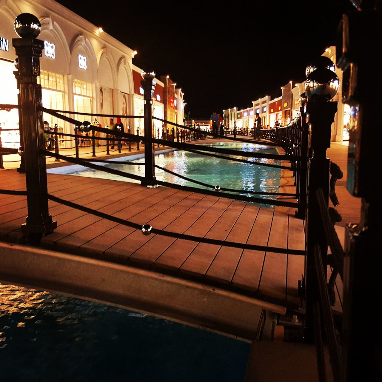 architecture, built structure, building exterior, night, illuminated, water, railing, no people, outdoors, sky, clear sky, city