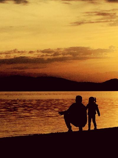 Sunset Two People Silhouette Togetherness Water Nature Beauty In Nature Scenics Sea Real People Men Love Sky Tranquil Scene Tranquility Leisure Activity Outdoors Bonding Vacations Lifestyles Light And Shadow Skyline Lake EyeEm Best Shots EyeEm