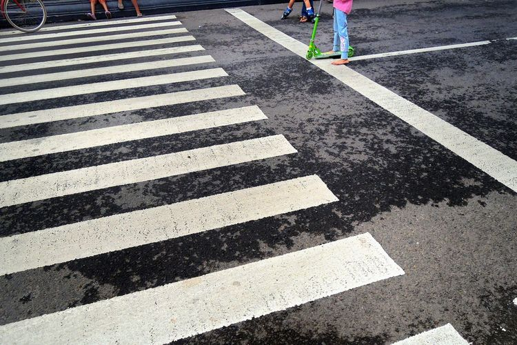 High angle view of zebra crossing marking on road