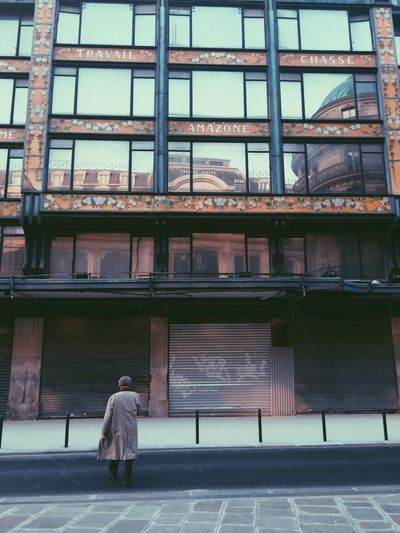 Woman standing in front of building