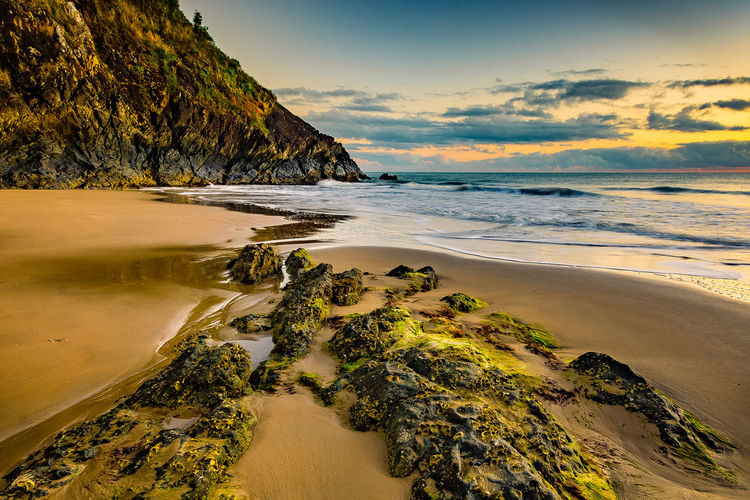 Surface Level Of Calm Beach Against The Sky