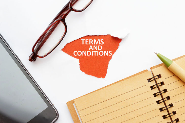 Terms and conditions Eyeglasses  Spectacle Terms And Conditions Concept Conceptual Smartphone Notebook Note Pad Blank Isolated White Background Isolated Text Word Business Rules Office Agreement Communication Text Close-up Note - Message Signing Horn Rimmed Glasses