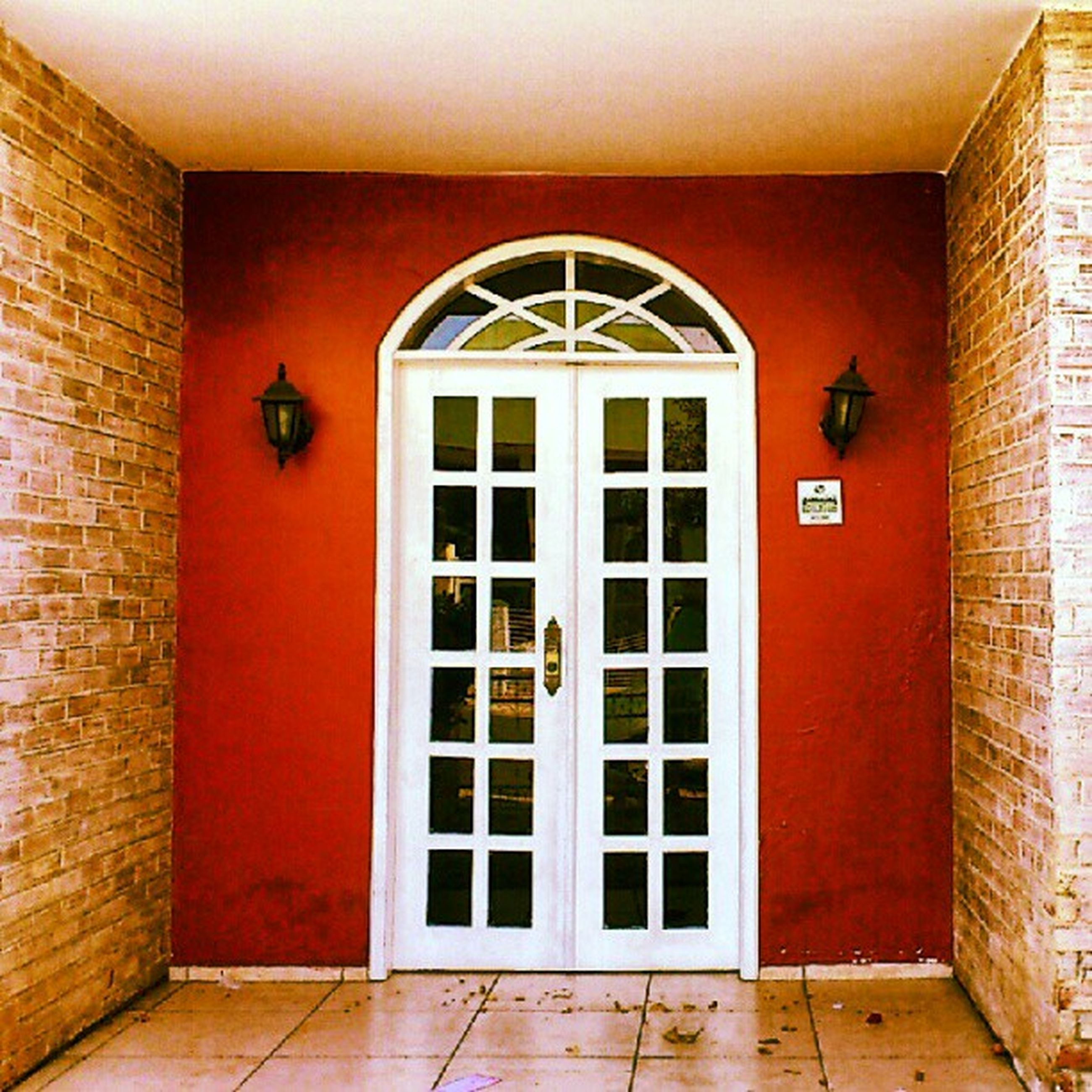 architecture, door, built structure, red, closed, building exterior, entrance, indoors, wall - building feature, window, house, wall, doorway, brick wall, safety, building, closed door, wood - material, no people, protection