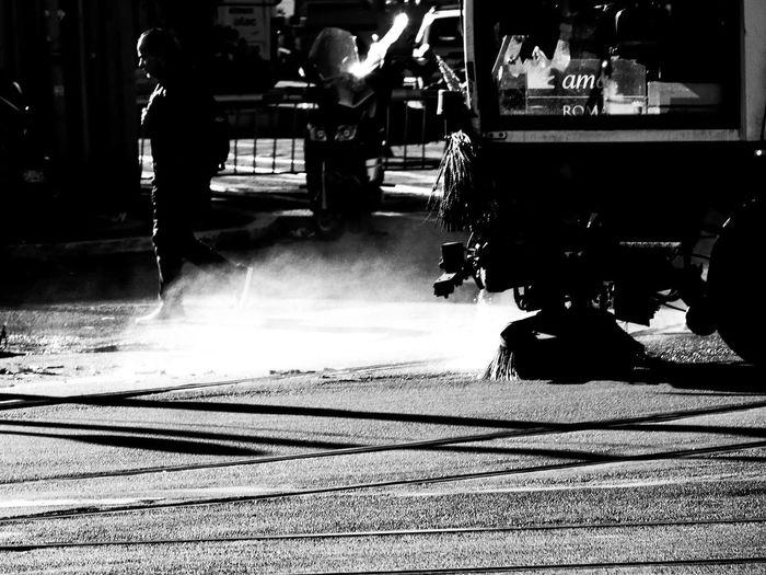 Man on sidewalk in city