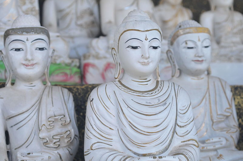Close-up of buddha statues for sale