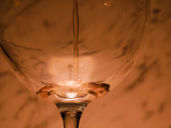Close-up Lighting Equipment Glass - Material Refreshment Focus On Foreground Illuminated Glass Light Bulb Food And Drink No People Drink Wineglass Indoors  Transparent Electricity  Low Angle View Filament Alcohol Single Object Light Electric Lamp Luminosity Ceiling
