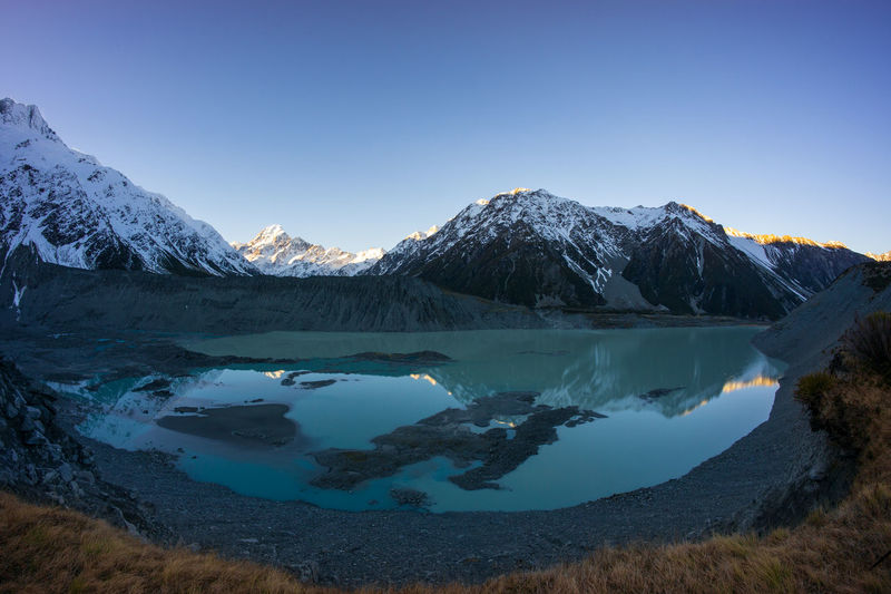 Glacier lake from Hookey Glacier with Mount Cook in the background Scenics - Nature Sky Cold Temperature Mountain Water Winter Beauty In Nature Tranquil Scene Tranquility Clear Sky Snow Mountain Range Lake Blue Nature Snowcapped Mountain No People Idyllic Ice Mountain Peak