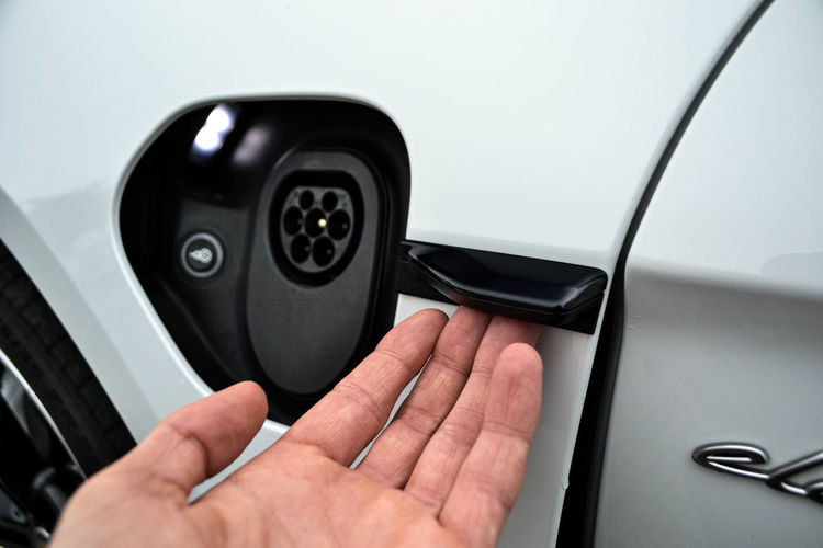 Close-up of hand holding car door
