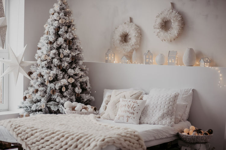 View of christmas decorations on bed at home