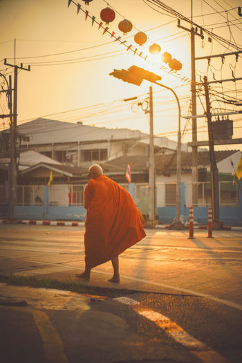 Buddhist monks are walking on a street in the morning and sunrise, vintage style filtered , selective focus Buddha Buddhist Dhama Life Morning Orange Snap Snapshots Of Life Walk Buddhism Candid Day Monk  One Person Outdoors People Real People Sky Snapshot Street Street Photography Streetphotography Sunrise Sunset Walking