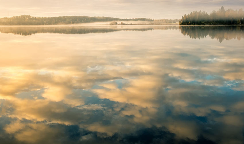 Reflections Atmosphere Atmospheric Mood Autumn Blue Calm Clouds Fall Focus On Foreground Fog Forest Lake Landscape MIS Mist Morning Light Nature Peaceful Reflection Reflections Sky Standing Water Sunrise