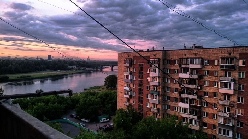 Battle Of The Cities Krasnoyrsk City River Cloud - Sky City Life No People Architecture Built Structure Building Exterior City Water River Sky Canal Power Line  Cloud - Sky Tree High Angle View Cloud Cable Power Cable City Life Power Supply No People Cloudy
