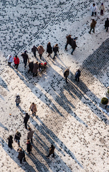High angle view of people on street during winter