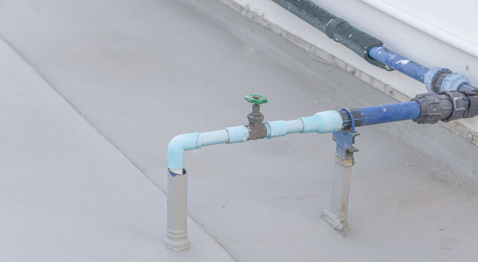 pipe Architecture Building Exterior Built Structure Close-up Connection Day Faucet High Angle View Metal Nature No People Outdoors Pipe Pipe - Tube Pipeline Place Silver Colored Valve Wall - Building Feature Water Pipe White Color