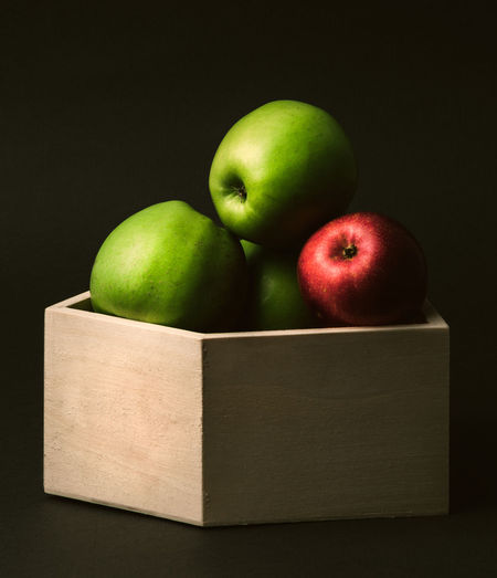 Close-up of apples in box