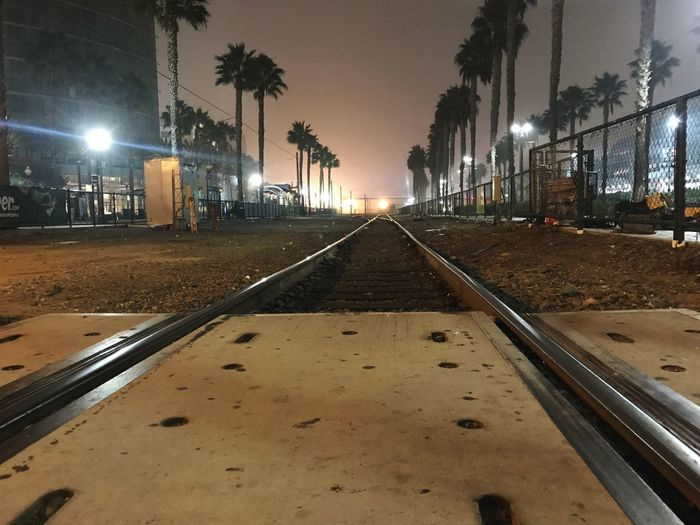 Late night in SD. Illuminated Night Tree Rail Transportation Track Railroad Track Direction Transportation City Street Light Diminishing Perspective First Eyeem Photo