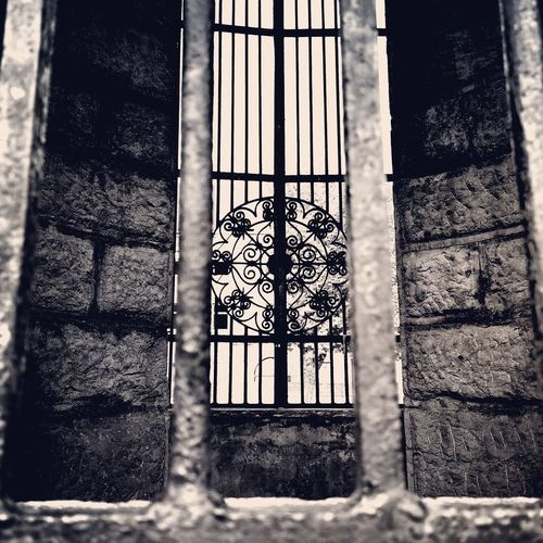 black and white Walking Around Metal Gate Window Blackandwhite Architecture AllBlackEverything City Oldbuilding Oldgate Old Behind Bars Bars Karlovac Photography Photoofday Backgrounds Security Bar Gate Rusty Urban Scene Entrance Closed Bad Condition Wrought Iron Entry Entryway