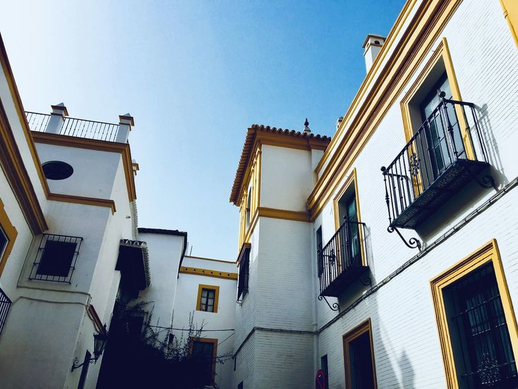 Look up Window Old City White Building Exterior Architecture Low Angle View Built Structure Window Outdoors No People Clear Sky Day Residential Building Yellow Sky City