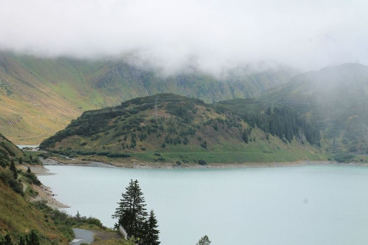 View of calm lake in foggy weather