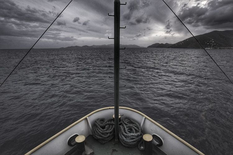 Cropped Boat Moving On Sea Against Cloudy Sky