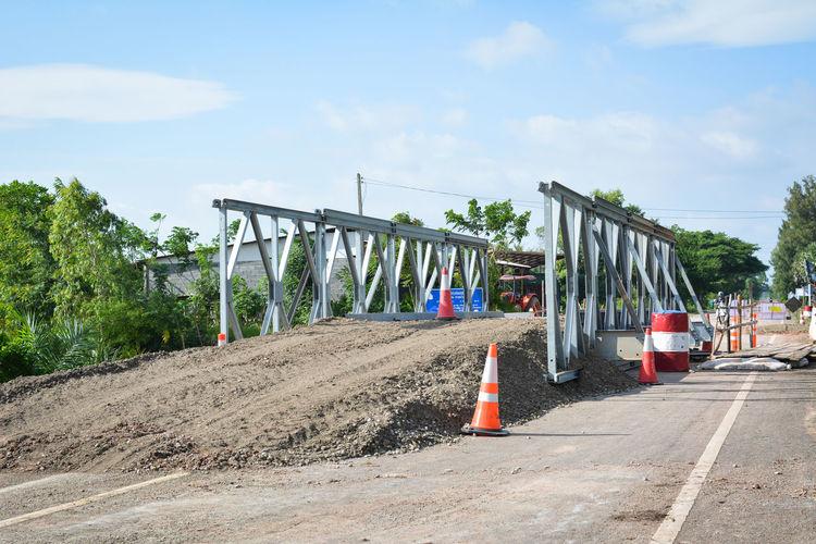 Incomplete bridge on road against sky