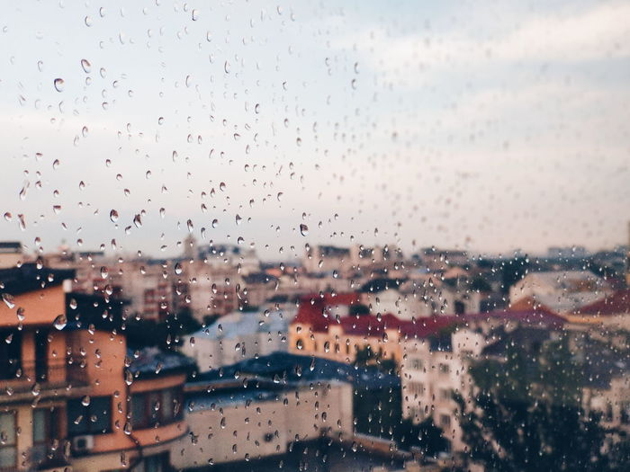 EyeEm Selects Cityscape City Water Backgrounds RainDrop Sea Drop Window Wet Weather Monsoon Rainy Season Water Drop Glass Rain Droplet Transparent Rainfall Looking Through Window