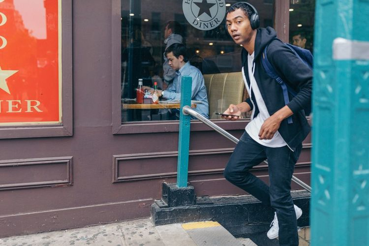 The Street Photographer - 2017 EyeEm Awards Young Adult Cafe Casual Clothing Real People Young Women Sitting Business Finance And Industry Owner Working Occupation Men Business Women Smiling Technology Day Lifestyles Full Length Outdoors City
