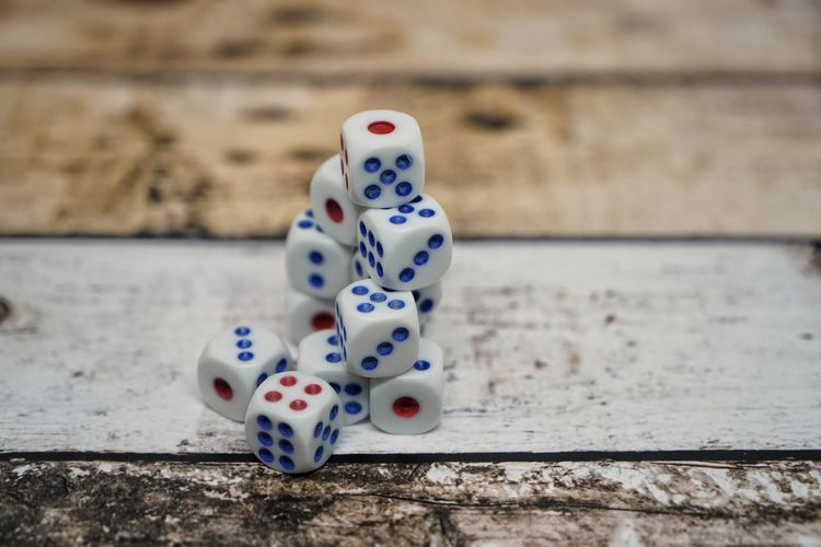 Arts Culture And Entertainment Close-up Dice Focus On Foreground Gambling Game Of Chance Group Of Objects High Angle View Indoors  Leisure Activity Leisure Games Luck No People Number Opportunity Relaxation Spotted Still Life Table White Color Wood - Material