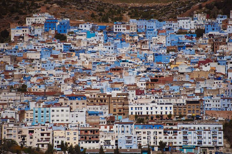 Chefchaouen. Full Frame Travel Destinations Vacations Outdoors Multi Colored No People Architecture Chefchaouen Blue City Morocco Travel Destination Exploring Africa Colors Architecture Traditional Cityscape Sunset Sunset_collection Buildings Colourful Buildings Connected By Travel