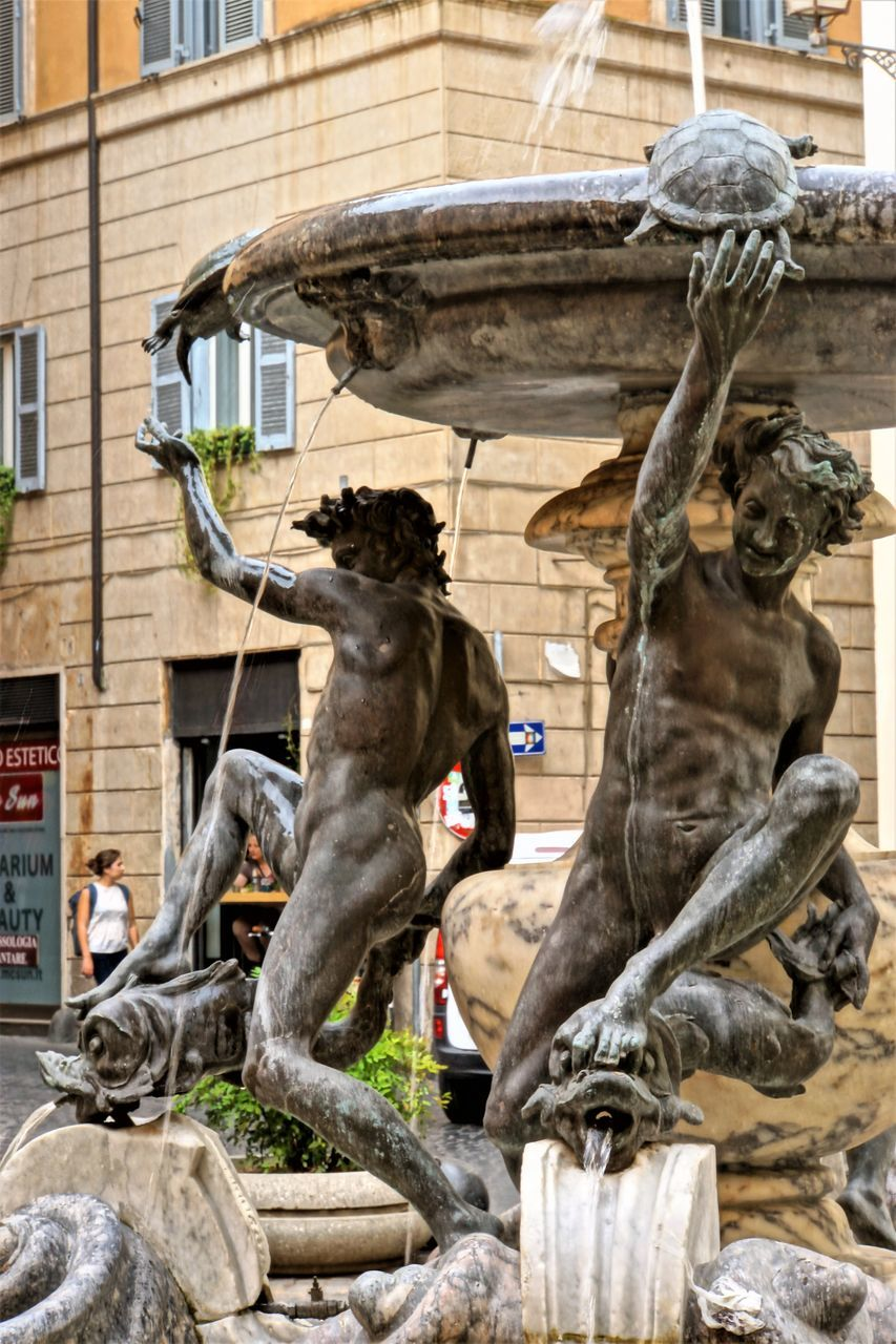 statue, sculpture, built structure, building exterior, architecture, outdoors, day, no people, animal themes, city