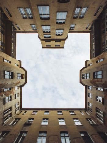Building Exterior Architecture Built Structure Sky Low Angle View City No People Cloud - Sky Outdoors Day Lookingup Tenement Houses Symmetry Symmetrical