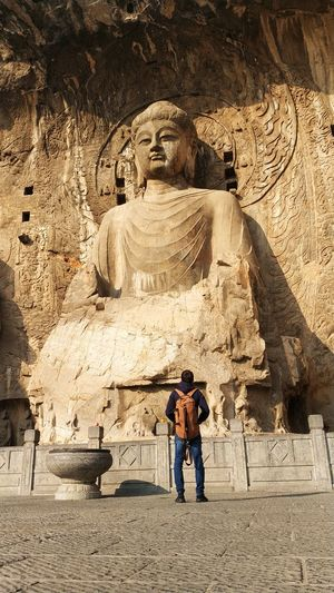 Longmen Grottoes Mountain Mountain Range Grottoes China Tradition Outside Meditation Buddhism Religion Spirituality Tranquil Scene Tranquility Relaxing Ancient Man Heritage Budha Men Standing Idol Place Of Worship Moments Of Happiness