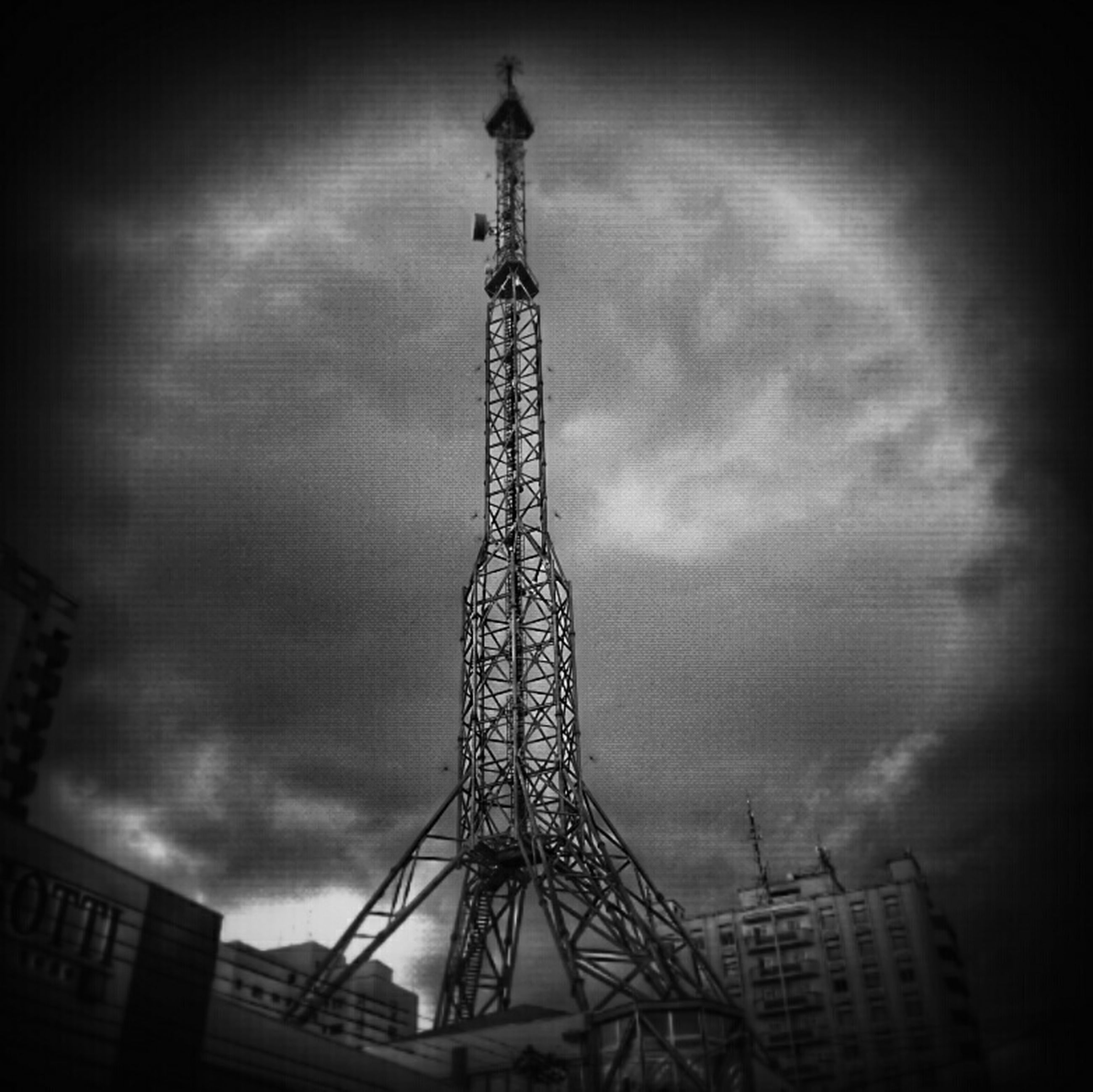 built structure, low angle view, architecture, sky, building exterior, tall - high, cloud - sky, crane - construction machinery, city, tower, auto post production filter, dusk, cloudy, development, outdoors, travel destinations, no people, silhouette, communications tower, capital cities