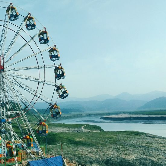 Live For The Story Ferris Wheel Amusement Park Day Outdoors Nature Sky Mountain Water Travelphotography Childhood Arts Culture And Entertainment Amusement Park Ride First Eyeem Photo EyeEmNewHere
