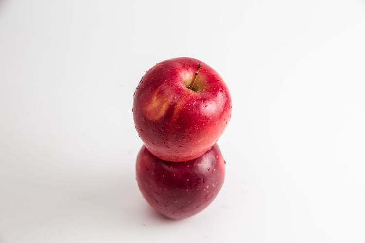 Healthy Eating Food And Drink Food Wellbeing Fruit Freshness Red White Background Studio Shot Apple - Fruit Still Life Indoors  Close-up Copy Space No People Cut Out Single Object Organic Apple Three Objects Healthy Lifestyle Diet & Fitness