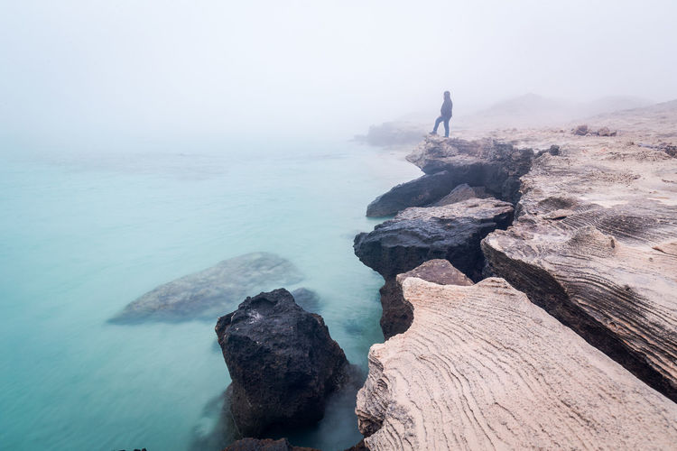 Beauty In Nature Day Fog Full Length Horizon Over Water Men Nature One Man Only One Person Outdoors People Rock - Object Scenics Sea Sky Tranquility Water