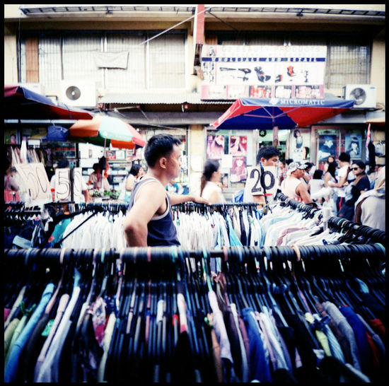 Commuting in Manila Manila Manila, Philippines ManilaStreetPhotography Outdoors Jeepney Travel Xpro Agfa RSX II Urban Analogue Photography Lomography Lensflare Photo Busride Public Bus Public Bus Manila Market Fruit Market Fashion Market Vendor Clothes Market Metropolis Cityscape
