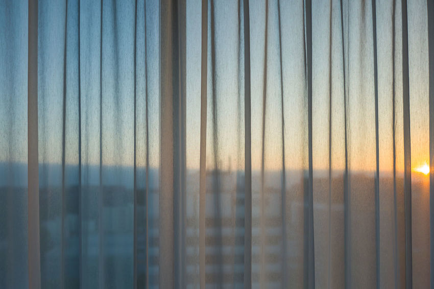 Hamburg sunset Backgrounds Beauty In Nature Close-up Curtain Day Full Frame Glass Glass - Material Nature No People Outdoors Pattern Reflection Security Sky Sunlight Sunset Textile Transparent Window
