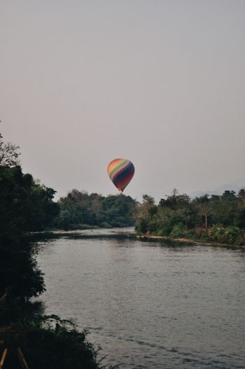 River Photography Travel Destinations Travel Backpack Water Hot Air Balloon Adventure Air Vehicle Flying Balloon Transportation Tree Sky Nature Mid-air Plant Extreme Sports Multi Colored Outdoors Parachute Day Lake Sport Parasailing